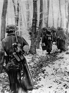 """30 December 1944 : German infantry marching through a snow-covered beech forest """"The winter battle in the West. Despite bitter resistance by the opponents, our troops continue to advance in the..."""