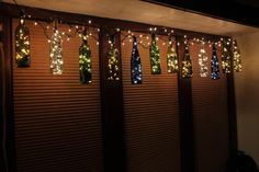 This strand of hanging wine bottle lights contains:  -6 Wine Bottles (assorted colors)  -Strand of 200 Christmas Lights (about 25 lights in each bottle, and 6 lights between bottle)  -Wire with loops, from which to hang bottles  -3 mounting eye screws  -Hanging Instructions   Vineyard illuminations by Stephan Olson of Lawrence Kansas