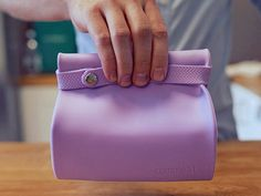Reusable lunch bag that keeps food fresh and protected and rolls up compactly for easy cleanup when your meal is over.