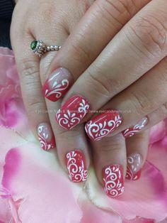 Raspberry gel polish with freehand gel nail art