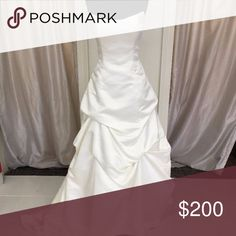 Wedding Gown Private Collection Style 8131-Sz 16 Beautiful strapless ball gown with pick up skirt and zippered back. Designer: Private Collection Size: 16 Color: Ivory Shows minimal signs of wear on hem, looks like dust marks, easily cleaned. Private Collection Dresses Wedding