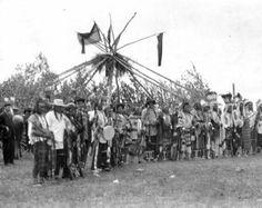 Blackfoot man in front of sundance lodge