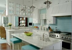 turquoise kitchen plus a few red-orange pops of color