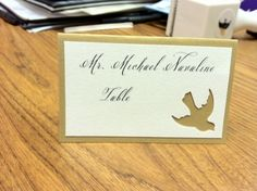 Gold escort cards with bird cutout and message inside :  wedding gold white ivory diy reception Card