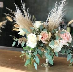 Wedding centerpiece floral arrangement using pampas grass roses Lavender Wedding Centerpieces, Halloween Wedding Centerpieces, Boho Wedding Flowers, Wedding Flower Arrangements, Flower Centerpieces, Floral Wedding, Floral Arrangement, Moana Centerpieces, Greenery Centerpiece
