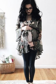 Stand out this season with this beautiful boho chic maternity kimono. With gorgeous floral print, feminine ruffles, and stylish sash tie, this kimono is this season's favorite essential. Layer this pretty little number over a basic top and your favorite maternity jeans for a complete look.