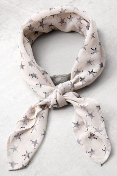 The styling possibilities are endless with the Vanessa Mooney Star Rush Cream Print Bandana! Sheer, lightweight woven bandana, with a cute star print, can be worn as a head-wrap, scarf, or however your heart desires. Bandana measures 30.5 wide and 30.5 long.