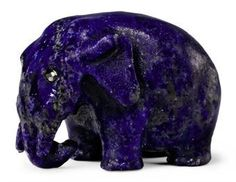 A Carved Lapis Lazuli Model of an Elephant  By Fabergé, circa 1900  Realistically carved, with rose-cut diamond eyes  1 in. Description from pinterest.com. I searched for this on bing.com/images