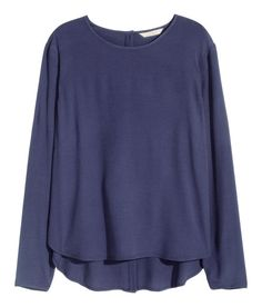 Check this out! Long-sleeved blouse in woven crêpe fabric with buttons at back. Slightly longer at back. - Visit hm.com to see more.