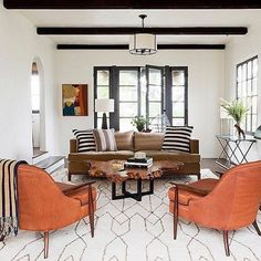 This desert modern living room is !! Pair a few mid-century leather pieces with colorful abstract art & natural accents and you're set.  (Check out the link in our profile to see a few of our fave rooms that nail this look.) : David Gilbert