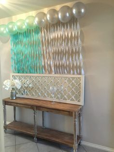 Mint and Grey baby shower, easy streamer waterfall over gift table.