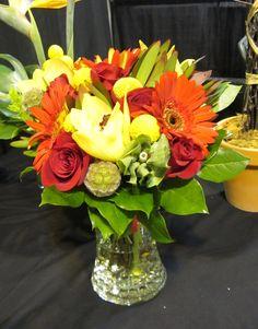 H.J. Benken Bridal bouquet with Gerbera Daisies, Bells of Ireland, Cymbidium Orchids, Roses, Scabiosa Pods, Billy Balls, and Safari Sunset by Benkens.com