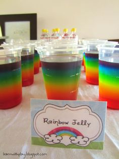 To make rainbow jelly (jell-o) cups you need to make up your jelly one layer at a time. Wait until one layer has set before adding the next (allow liquid jelly to get to room temperature before pouring on top of set jelly layer). Set and repeat till done.