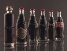 Coca Cola history (left to right)... 1899 - 1904 - 1915 - 1920 - 1957 - 1986