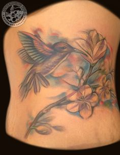 Beautiful pastel hummingbird piece done quite recently by Trevor Jameus #ascendingkoi #calgarytattoos #tattoos #hummingbird #birdtattoos