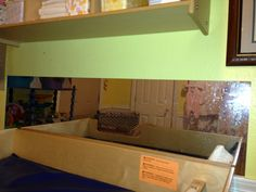 A safety mirror added parallel to the length of the changing table in the nursery.