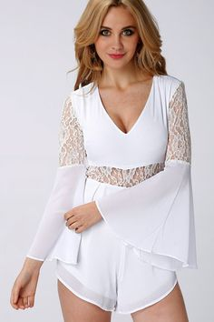 Look classy and poised with this amazing white playsuit. This long sleeves playsuit with lace details, plunging V neckline, flare sleeves,sheer-through at waist and back and ruffled hem for a polished chic look. Style it simply withfine gold accessoriesand soft tresses.