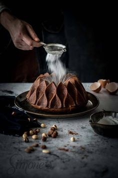 Chocolate bundt cake with hazelnuts and roasted almonds