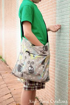 """I made these bags for my boys earlier in the spring, and now I'm finally getting around to sharing this Boys Messenger Bag Pattern with you all. The boys love hauling their things {junk, ha!} around when we go out. Jack always asks me to make him a """"purse"""" like I make for me, so …"""