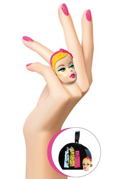 Turn heads in a painted cocktail ring shaped like a vintage Barbie® doll head atop an expandable band. Ring arrives in a mini illustrated hat box.