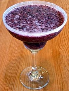 Amazing Blueberry Margaritas Fresh orange juice or lime juice (optional)  3 cups ice  1/3 cup tequila  2 cups fresh or frozen blueberries  1 (6-ounce) can frozen limeade concentrate  1/4 cup powdered sugar  1/4 cup orange liqueur  Dip rims of glasses in orange juice and dip in sugar crystals to coat (optional) Process ice and next 5 ingredients in blender until smooth. Serve in prepared glasses.