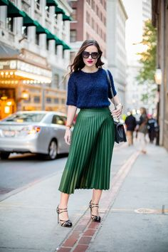 3e4c5c6455b1 A blue fuzzy knit sweater and kelly green pleated midi skirt gives off a  sophisticated and ladylike vibe.