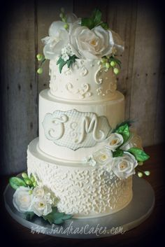 Classic wedding cake with wafer paper flowers.