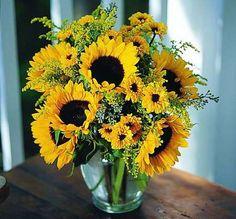 Sunflowers arranged in a vase @ the Kremp Florist link on www.greenearthdealsonline.com