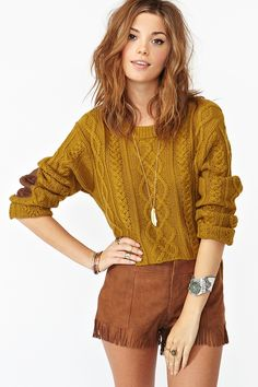 Snazzy heavy knit sweater with elbow patch detailing! Slightly cropped with a dipped back! Cute with high wasted jeans or or sweater shorts! $68