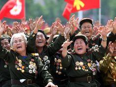 North Korean war veterans cry as they parade past their leader Kim Jong Un