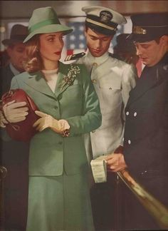 1940s Suit green jacket skirt hat purse gloves white color photo print ad model war era vintage fashion style