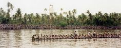 https://flic.kr/p/7Gxnyu | India, Kerala, Nehry Trophy race | A racing long boat, holding about 100 paddlers.  Note the tens of thousands of spectators sitting in bleachers along the shore.