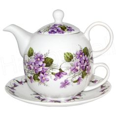 .well...this shows my 'age'?...these are 'cute' teapots...how-some-ever...they are either single person or sharing/love-cup pots///I don't Get them.....anyway..pretty violets!.lol..dkw