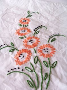 faces for the center of flowers idea - embroidery pattern