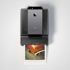 Impossible Instant Lab from Firebox.com. Takes your iPhones photos and makes them into Polaroid photos instantly!