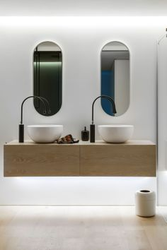 Clean, Simple Lines by Minosa Design. Curves...off set faucets, round vessel sinks.