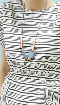 The Nampula Wooden Bead & Metal Necklace is the epitome of a statement piece.
