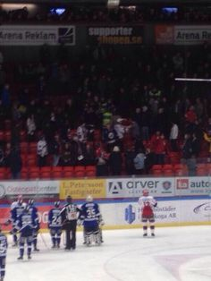 In Sweden, the hockey game stops to see a fight in the stands.