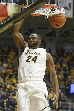 Wichita State's Shaq Morris dunks against Southern Nazarene's Chris Stephens during the first half at Koch Arena on Tuesday night.