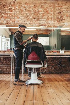 Hairdresser giving haircut to client by Jacob Lund Photography on @creativemarket