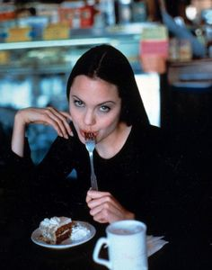 Angelina Jolie eating delicious cake