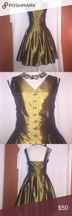 STUNNING VINTAGE 90's PARTY DRESS Faux silk. Color is a dark olive sheen. Has side zipper, box pleat and front buttons can unbutton. Wear it to any party and you will look fabulous. Excellent condition  IN-WEAR Dresses