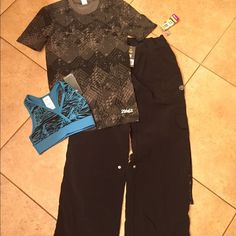 NWT bundle of 3 size XS/S. #703 NWT bundle includes a pair of cargo pants size S A graphic shirt size XS A race back sports bra size XS Tags attached no flaws Zumba Other