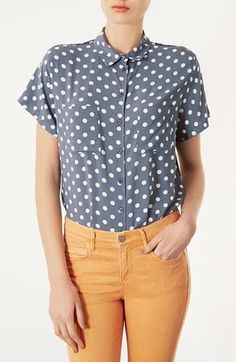 Blue Topshop Polka Dot shirt paired with peach denim.