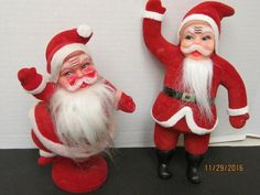 "Two Vintage Flocked Santas Celluloid faces 9"" One Dancing, One Waving"