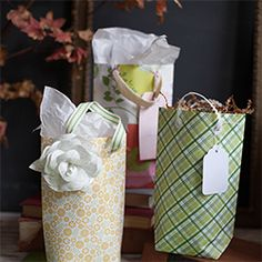 Learn how to make a diy gift bag out of a sheet of scrapbook paper with a step by step tutorial.