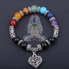 """Vous avez l'impression que vos chakras sont en déséquilibre ? Notre Bracelet 7 Chakras """"Guérison & Amour"""" restaure et équilibre la vibration de vos 7 chakras pour vous aider à retrouver une parfaite santé émotionnelle, spirituelle, mentale et physique. C'est un cadeau parfait pour tout pratiquant de Yoga ou de méditation. OBTENEZ LE MAINTENANT AVEC 50% DE RÉDUCTION !"""