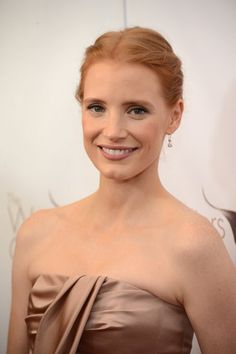 Jessica Chastain: The Zero Dark Thirty actress stuck to a neutral makeup palette to match her blush-toned dress. For her hair, Jessica opted for a swept-back updo with subtle twists on the sides.