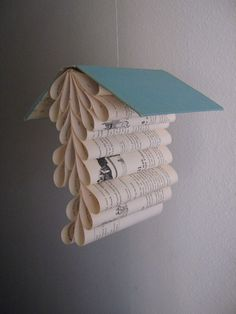 Book Mobile Upcycled from a Vintage Copy of by ModernTypography, $50.00 -- I would like to make some of these for my classroom! They could hang from the ceiling. I have so many books!