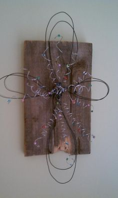 Wire  Bead Cross attached to an old piece of wood. crafts